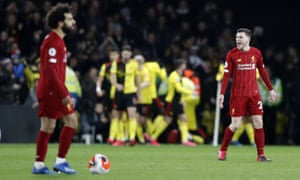 Liverpool's Andrew Robertson, right, reacts as Watford players celebrate after Troy Deeney scores their third goal.