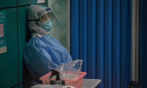 A medical worker wait for patients to be tested for the Covid-19 novel coronavirus in Wuhan, Chinas on 14 May 2020.