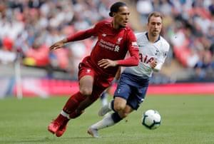 Spurs' Christian Eriksen gives chase as Liverpool's Virgil Van Dijk surges forward.