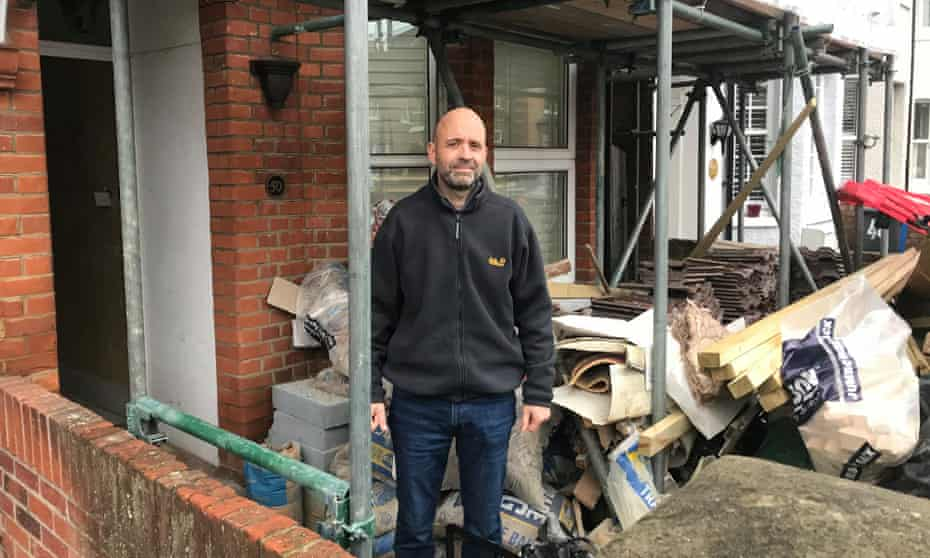 James Hobby outside his house after the roof collapse.