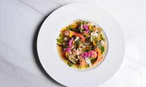 Seafood dish from Paste, Bangkok, served on a white plate and photographed from above.