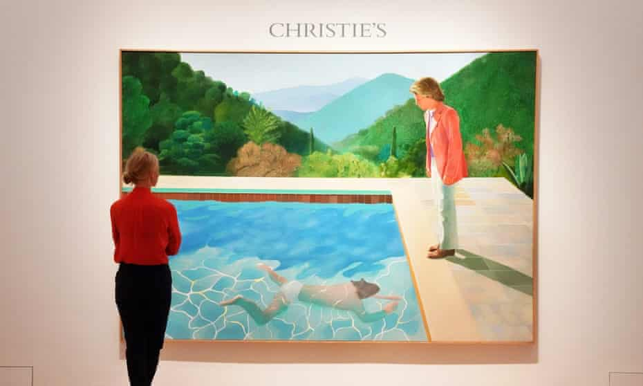 A woman looks at Portrait of an Artist (Pool with Two Figures) at a press preview.