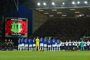 The two teams line up to observe a minutes silence.