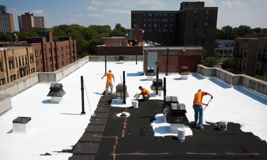Volunteers paint a Bronx, New York, rooftop with a coating that has a high solar reflectivity and infrared emissivity