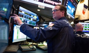 Traders and financial professionals on the floor of the New York Stock Exchange as the UK went to the polls.