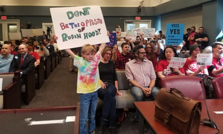 A young protester makes his point at an Arlington county board meeting discussing Amazon's development plans in the Virginia, city. Photograph: Nandita Bose/Reuters