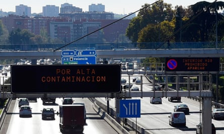 Smog hangs over Mardrid and road signs warn of speed limits in place due to air pollution. About 3,000 people die prematurely in the city every year due to pollution.