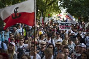 "Protesters are seen waving Polish flags during a demonstration organised by opponents of restrictions related to the coronavirus pandemic in Warsaw, Poland, on 12 September 2020, with participants chanting ""No more lies, no more masks, stop the pandemic""."