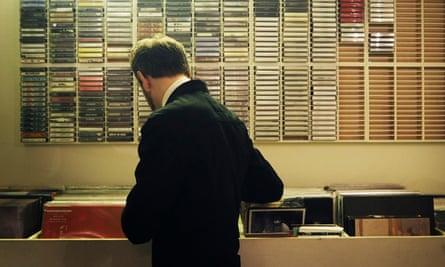 A man browses the racks of vinyl at Posh Isolation, Copenhagen