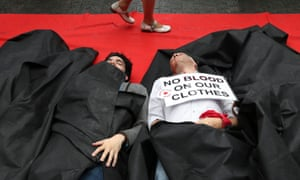 Activists protest in Brussels on the first anniversary in 2014 of Bangladesh's Rana Plaza factory collapse.