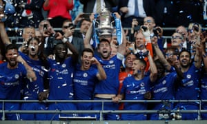Chelsea's English defender Gary Cahill lifts the trophy as Chelsea players celebrate their win after the English FA Cup final