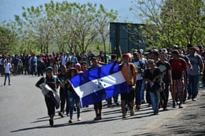 Honduran migrants heading to Puerto Barrios, in Guatemala, after breaking a police fence at the border crossing between Honduras and Guatemala, on Wednesday.