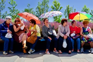 Women chat in the sunshine in Fubchal, Portugal