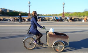 mother and child on cargo bicycle in copenhagen