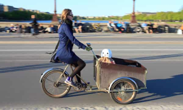 A mother and her child using a cargo bike