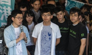 Pro-democracy activists Nathan Law (L), Joshua Wong (C) and Alex Chow (R)