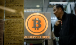 A shop displays the bitcoin sign during the opening of the first bitcoin retail shop in Hong Kong last year.