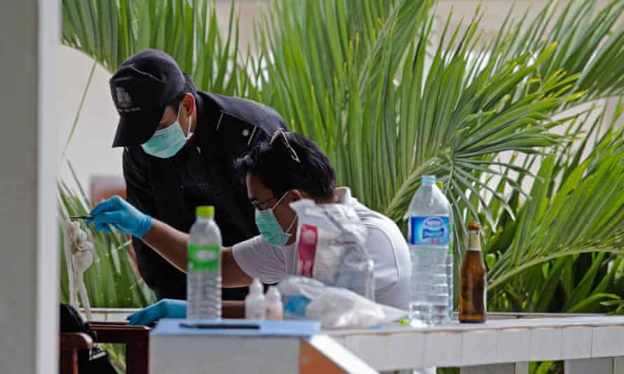 Thai forensic investigators inspect a hotel room in Koh Tao where one of two murdered Britons was staying.
