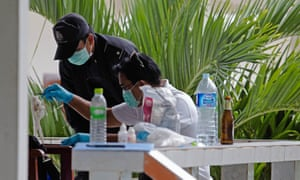 Thai forensic investigators inspect a hotel room where one of two murdered British backpackers stayed on Koh Tao.
