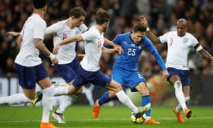 England's James Tarkowski, second left, fouls Italy's Federico Chiesa, after which a penalty is awarded following a VAR review.
