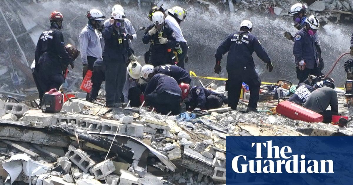 Miami condo collapse: death toll rises to five as crews search pile for survivors