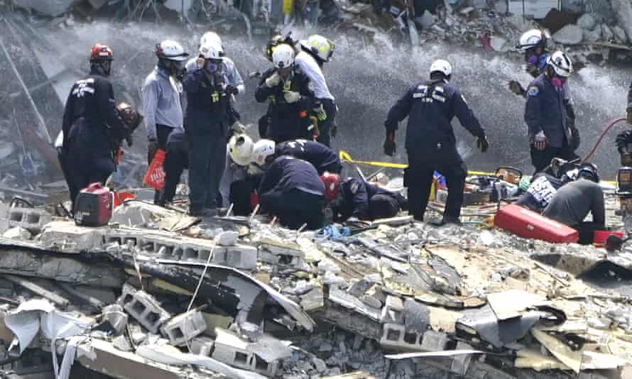 Rescue workers search the rubble of the Champlain Towers South.
