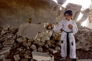 Nur Setut, born in 2011 when Syrian civil war began, practises karate, with dreams of becoming a world-class champion, Aleppo, Syria