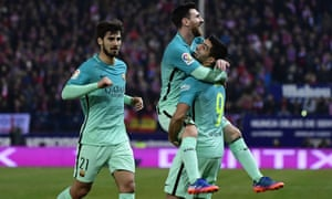 Barcelona goalscorers Lionel Messi and Luis Suárez celebrate with André Gomes as they won 2-1 at Atlético Madrid.