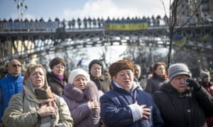 Women sing the Ukrainian national anthem in Kiev, 2014