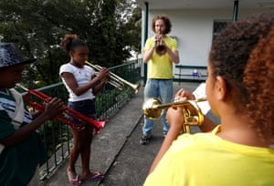 Tom Ashe rehearsing with trumpet players. The project also offers free English lessons to the Children
