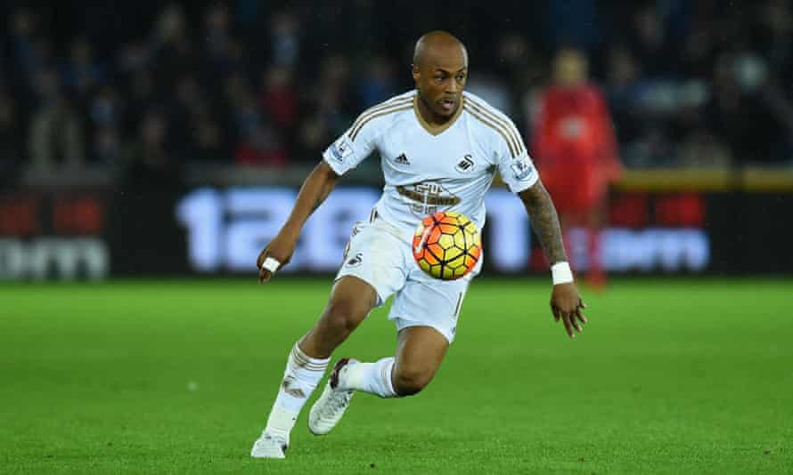 Swansea's André Ayew surges forward.