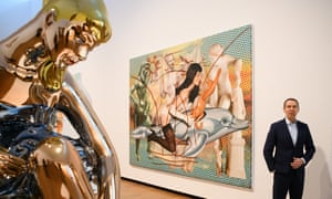 Jeff Koons beside his painting of Antiquity 2, depicting Gretchen Mol as Bettie Page.