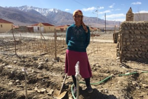 Nuyuft Arkin, a 45-year- old farmer, outside the new home on the outskirts of Tashkurgan.