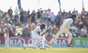 England wicket keeper Ben Foakes races past a dejected Niroshan Dickwella as he celebrates after the Sri Lankan batsman was caught.