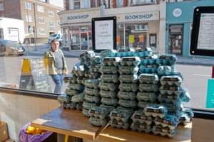 Egg boxes stacked high in a window near Clapham Junction