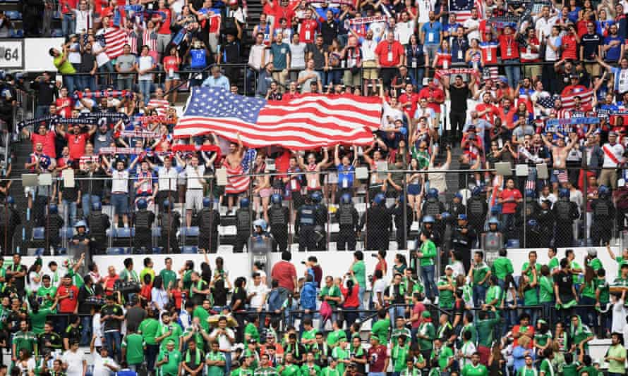 US fans listen to their national anthem before the start of the game