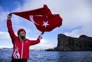 Ercümen waves a Turkey flag
