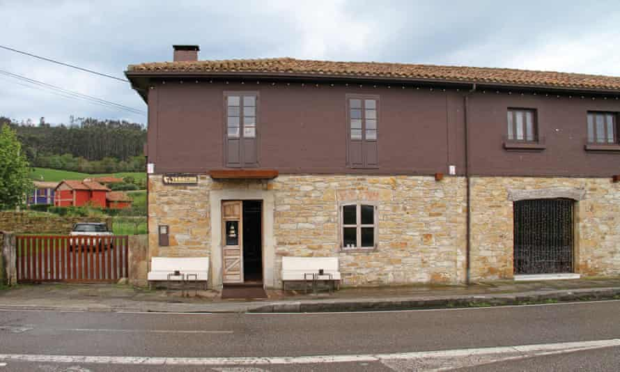 Exterior shot of the stone and wood building that houses Soda 917 in Villaviciosa, Asturias. The unassuming tobacco shop is famous for its cocktails.