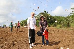 UK climate strike activist Elijah McKenzie-Jackson sows carbon offset seeds with Forest COP initiator Eliane Brum.