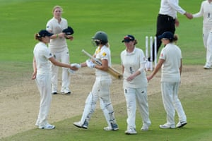Ellyse Perry of Australia shakes hands with Natalie Sciver of England.