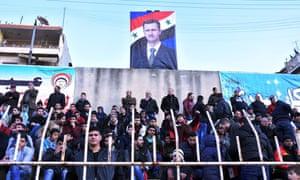 A portrait of Syrian president Bashar al-Assad hangs in the stadium during a football match between derby rivals Al-Ittihad and Al-Hurriya last month