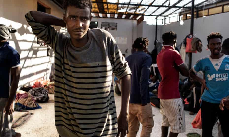 Migrant inside the Triq-al-Sikka detention centre in Tripoli, Libya.