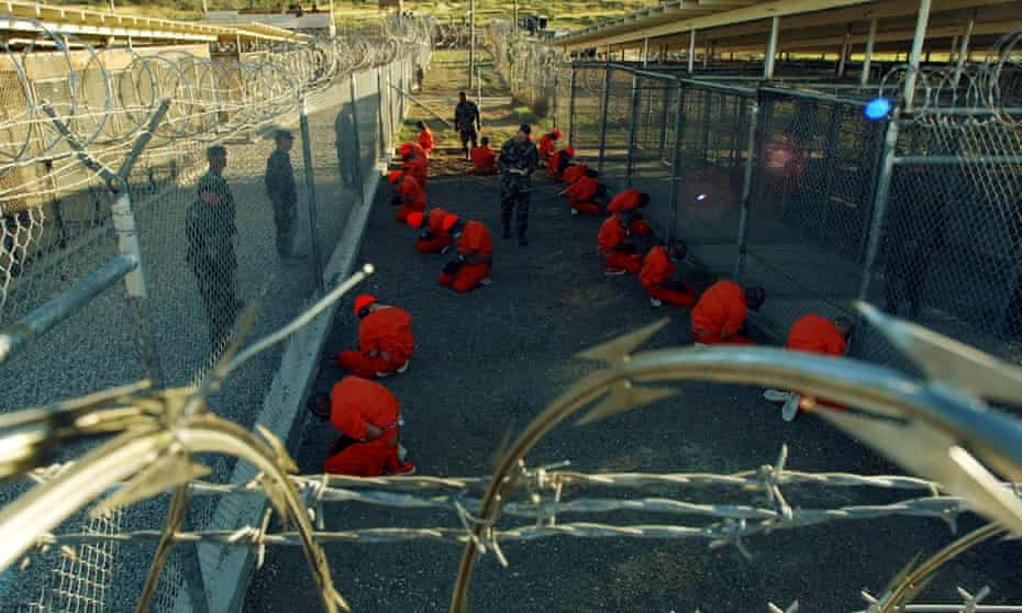 US Department of Defense photo of detainees sitting in a holding area at Guantánamo Bay in January 2002