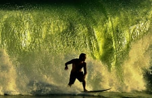Rio de Janeiro, BrazilA surfer catches a wave in Rio de Janeiro.