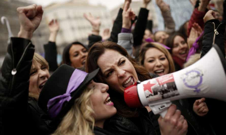 Spanish women mark International Women's Day with the first-ever full day strike and dozens of protests across the country against wage gap and gender violence.