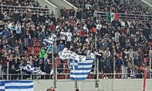 Greek fans pictured holding the offensive banner during Sunday's World Cup qualifier.