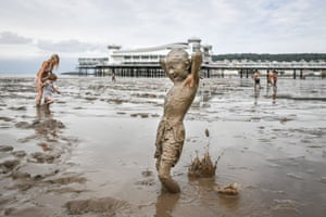 Weston-super-Mare, UKBlaze, 8, from Swindon, is covered from head-to-toe as he plays in the mud on the beach as the tide recedes and the huge expanse of mud flats cover the beach where holidaymakers enjoy splashing around. RNLI warning: The mud flats at Weston (and, in fact, any other part of our coastline) can be highly dangerous. Several years ago a five-year-old girl died near Weston after being overwhelmed by the incoming tide after getting trapped in mudflats. RNLI lifeboat crews in that area are frequently called out to rescue people who have become trapped in the mud