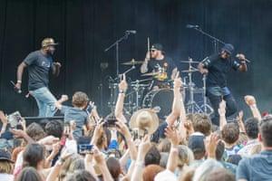 Arnhem Land singer Yirrmal (left) joins rapper and cousin Baker Boy (right) on stage to sing Marryuna.