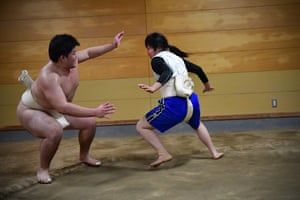 Kotone Hori, a member of Asahi University's women's sumo team, wrestles with a male opponent at a training session in October 2018