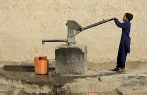 A boy drawing drinking water from a hand pump in Peshawar, Pakistan March 4, 2016.